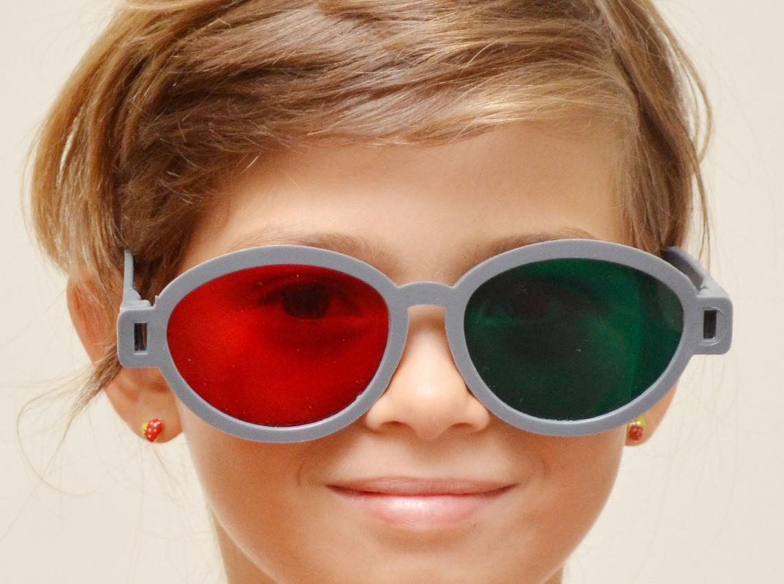 girl wearing red green glasses for vision therapy