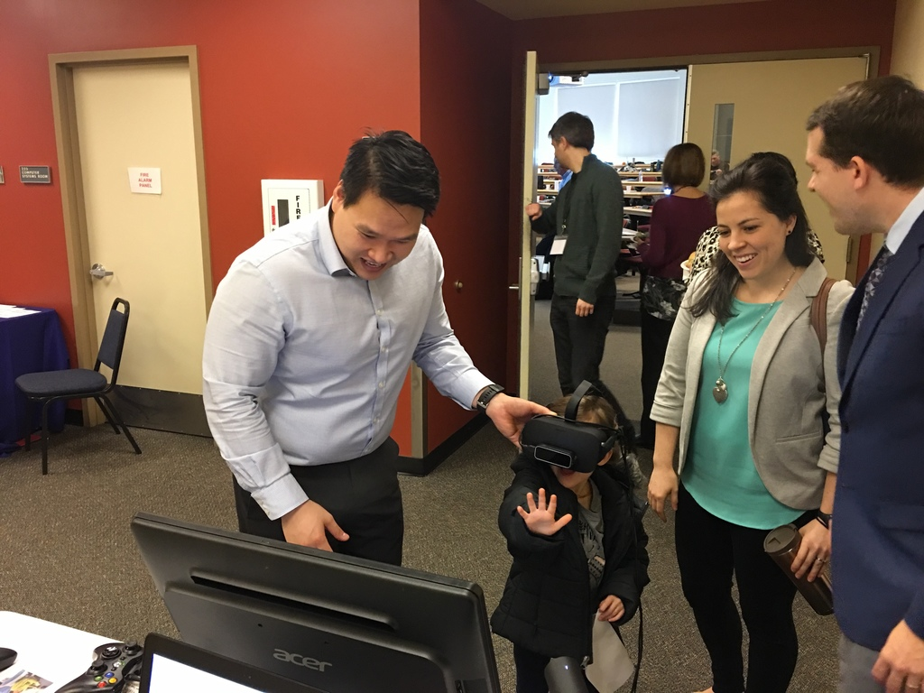 Dr. Tuan Tran showing off the Vivid Vision system at a conference.