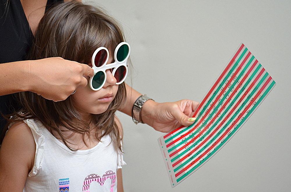 girl with red green glasses